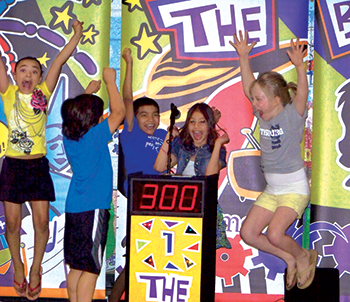 Students jumping in excitement as they win points in The Brain Show